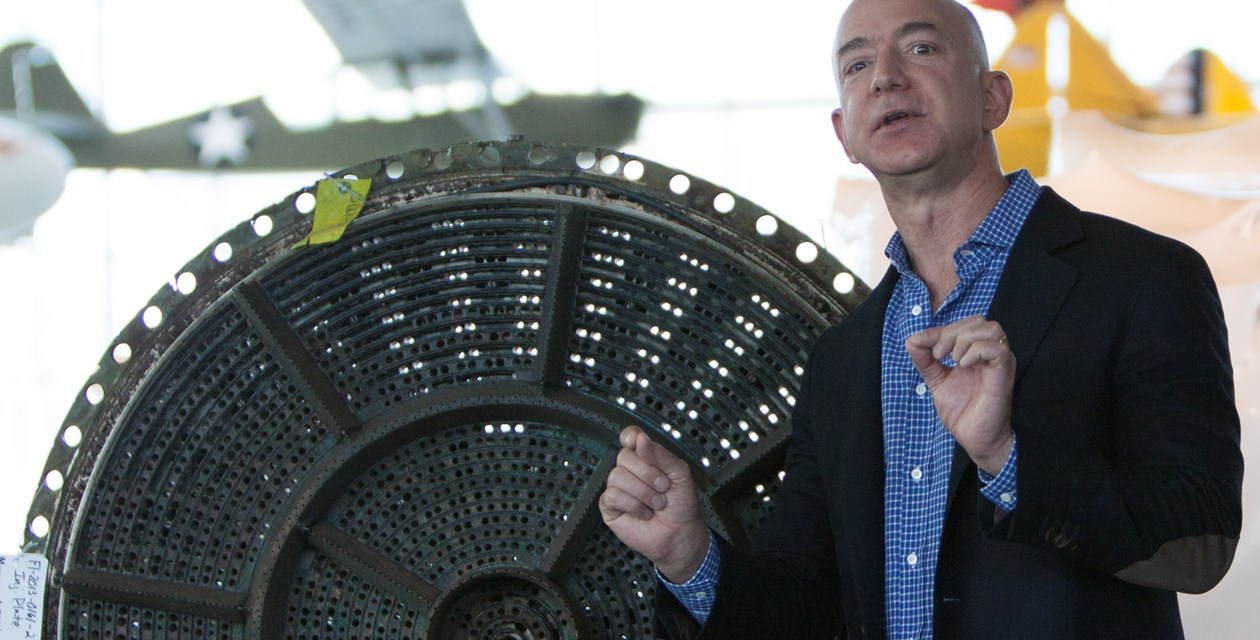 Jeff Bezos at Museum with F-1 part