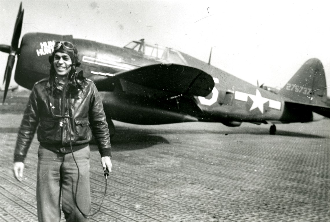 Major Louis W. 'Bill' Chick Jr. smiles as he stands with Lieutenant Eugene Emmons's 'Hun Hunter,' a Republic P-47D Thunderbolt of the 325th Fighter Group, 317th Fighter Squadron, United States Air Force. Circa 1943 or 1944. - Major Louis W. 'Bill' Chick Jr. smiles as he stands with Lieutenant Eugene Emmons's 'Hun Hunter,' a Republic P-47D Thunderbolt of the 325th Fighter Group, 317th Fighter Squadron, United States Air Force. Circa 1943 or 1944.