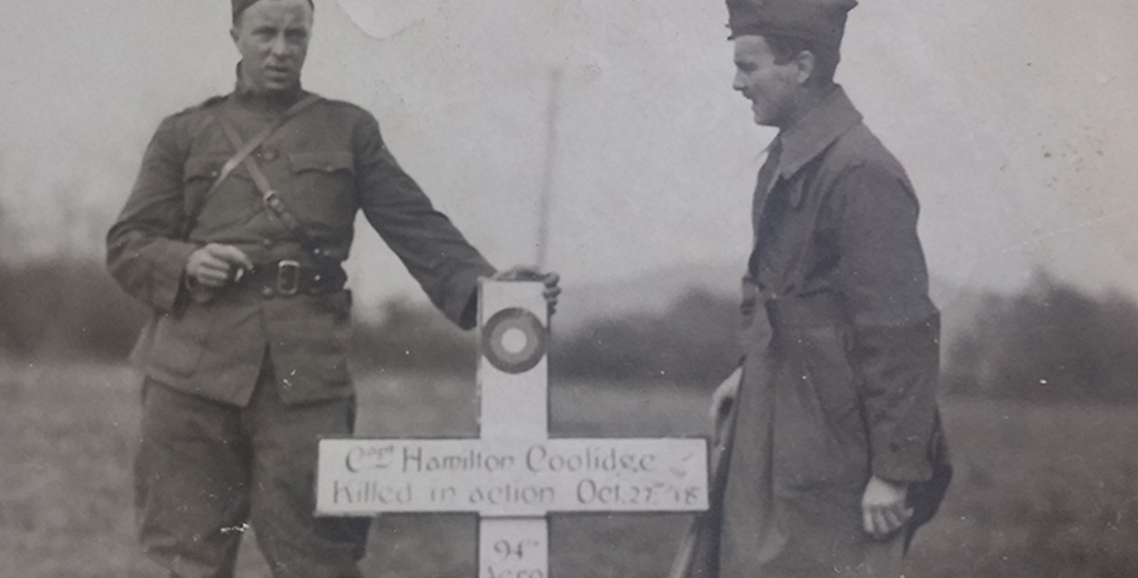 Coolidge-1 - Two men with the grave marker of Hamilton Coolidge, killed in action October 27, 1918.