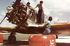 Three naval mechanics repair a Pratt & Whitney Wasp powered SNJ Texan trainer, circa 1943.  Credit: United States Navy