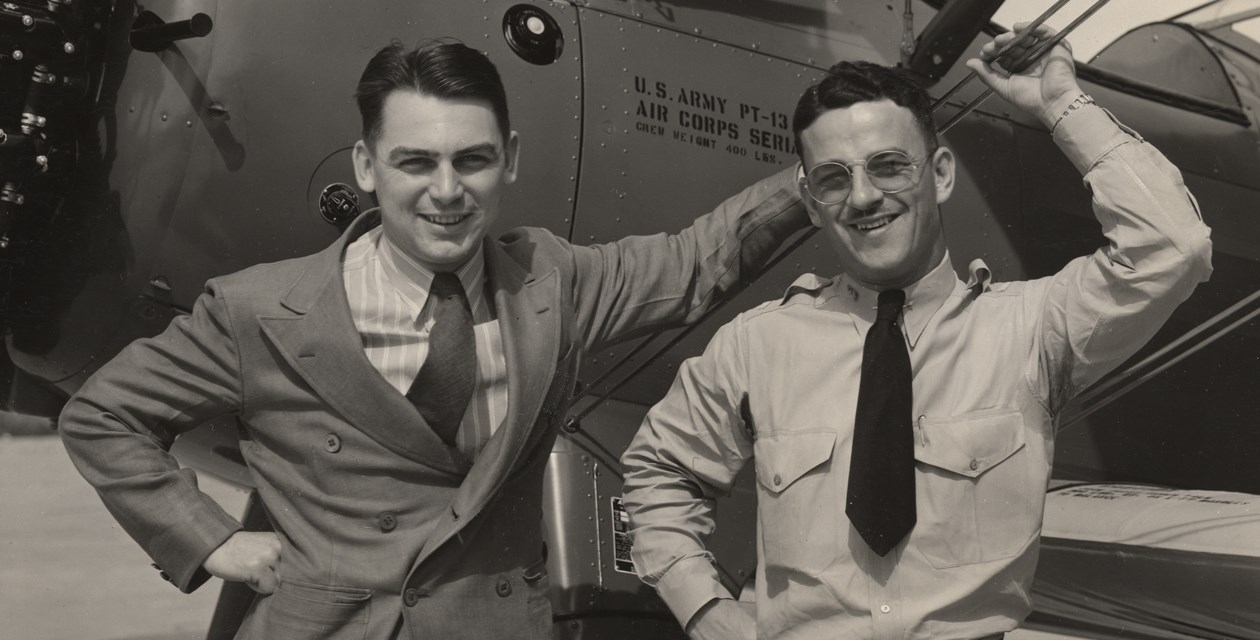 Zipp-1 - Harold Zipp (left) and an unknown man pose with a US Army Air Corps Stearman PT-13D Kaydet.