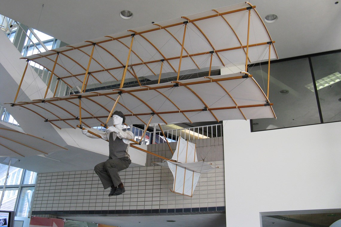 The Museum's Chanute-Herring 1896 Biplane Glider Reproduction on display in the Lobby