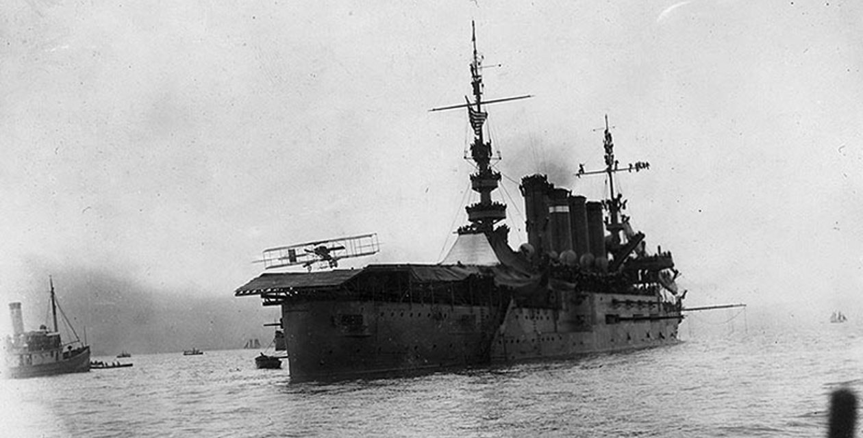 Eugene B. Ely lands his Curtiss pusher biplane on the USS Pennsylvania  becoming the first pilot to land on a warship on January 18th, 1911. (U.S. Naval Historical Center)