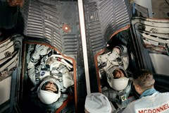 L. Gordon Cooper and Pete Conrad climb into their Gemini capsule prior to the launch of Gemini V -NASA