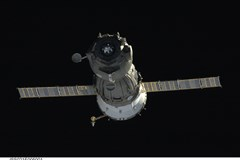Backdropped by the blackness of space, the Soyuz TMA-14 spacecraft departs from the International Space Station