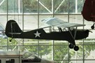 The Museum's Aeronca L-3B (O-58B) Grasshopper on display in the Great Gallery