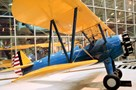 The Museum's Stearman PT-13A Kaydet (A75) on display in the Great Gallery